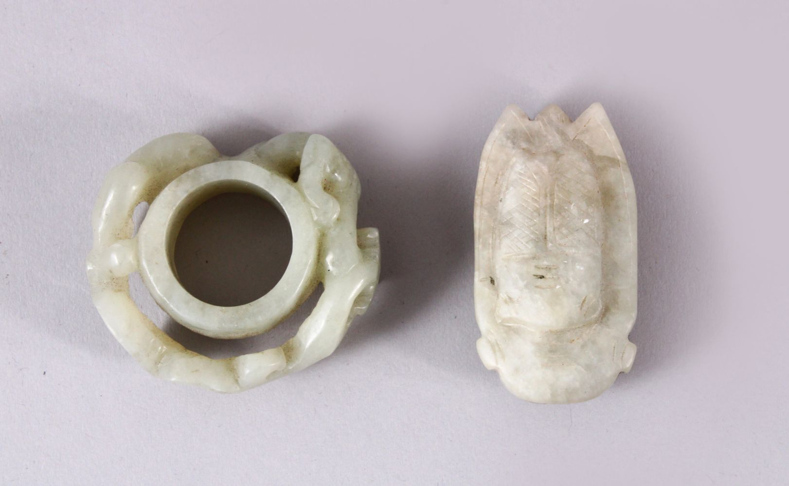 TWO CHINESE CARVED JADE PENDANTS, one carved with chilong, 5cm, and one carved int he form of a