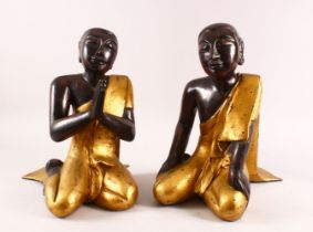 A PAIR OF LARGE THAI / TIBET CARVED WOOD & LACQUER FIGURES, both in knealt positions in gilded