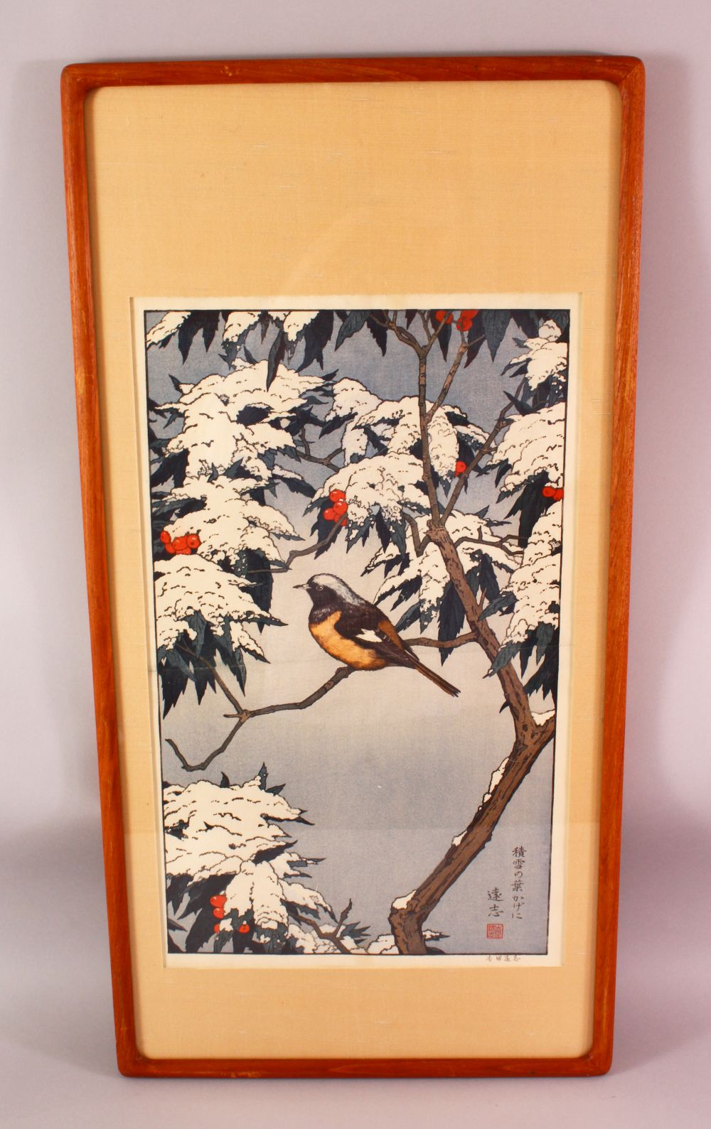 A LARGER JAPANESE WOODBLOCK PRINT BY TOSHI YOSHIDA 1911 - 1995, sitting under snow covered