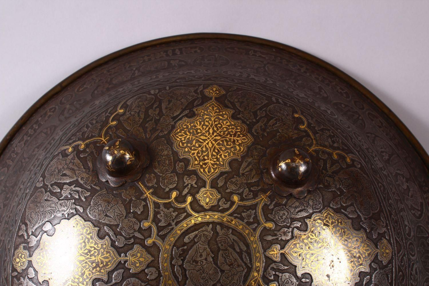 A LARGE 19TH CENTURY PERSIAN GILT DECORATED STEEL SHIELD, with carved decoration of figures, bands - Image 6 of 12