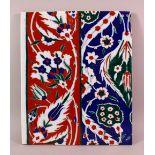A TURISH IZNIK STYLE POTTERY TILE SECTION, with floral decoration, 33cm x 27cm