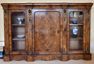 A GOOD VICTORIAN FIGURED WALNUT CREDENZA, the front with central panel drawer, flanked by glass