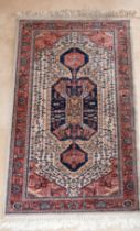 A SMALL PERSIAN RUG with large medallion. 5ft x 2ft 8ins.