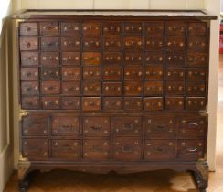 A CHINESE NARROW CABINET with SIXTY-TWO DRAWERS. 3ft 9ins long x 1ft deep x 3ft 4ins high.