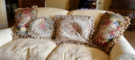 FOUR VARIOUS TAPESTRY COVERED CUSHIONS.