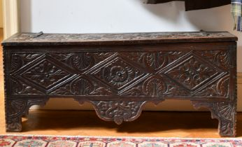 A 17TH CENTURY CARVED OAK SWORD CHEST. 3ft 9ins long x 1ft wide.