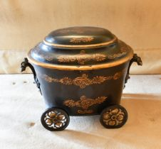 A VICTORIAN OVAL PONTYPOOL COAL BOX AND COVER on four wheels. 1ft 8ins.