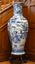 A LARGE CHINESE PORCELAIN BLUE AND WHITE VASE OF KANG HSI DESIGN with many figures and emblems, on a