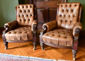 A GOOD PAIR OF VICTORIAN MAHOGANY GREEN STUDDED LEATHER ARMCHAIRS, with iron studs, on carved legs