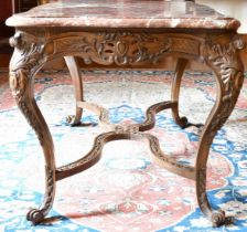 A GOOD FRENCH VEINED MARBLE TOP CENTRE TABLE with serpentine sides, on a wooden stand with carved