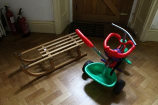 A CHILD'S SLEDGE AND TRACTOR (2).