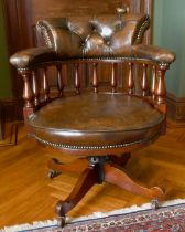 A GOOD MAHOGANY AND LEATHER TUB SWIVEL OFFICE CHAIR with buttoned back.