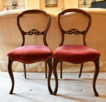 A SET OF FOUR VICTORIAN CABRIOLE LEG CHAIRS.