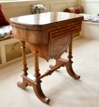 A GOOD VICTORIAN WALNUT GAMES AND SEWING STAND, the folding top opening to reveal backgammon,