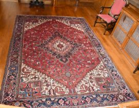 A LARGE GOOD PERSIAN CARPET with large central medallion, mainly in reds and blues. 12ft x 9ft