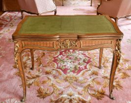 AN 18TH CENTURY FRENCH BUREAU PLAT with pull-out ends, set with green leather with rich ormolu