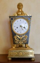 A SUPERB EMPIRE ORMOLU AND BRONZE CLOCK by CHOMIFIEU PARIS of Egyptian design with sphinx and claw