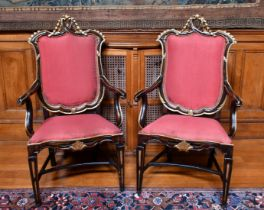A GOOD PAIR OF ITALIAN GILDED ARMCHAIRS with padded backs, drop-in seats, on tapering legs.