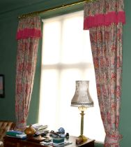 A PAIR OF FULL-LENGTH CURTAINS.