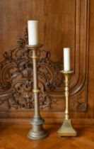 A GILT AND A SILVERED CANDLESTAND (2). 1ft 10ins and 2ft 6ins high.