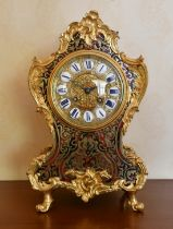 A MID 19TH CENTURY, FRENCH, BOULLE MANTLE CLOCK, the shaped body with all-over cut brass and