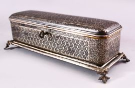 A BIDRI STYLE RECTANGULAR HINGED CASKET for the European market, with panels of scrolling