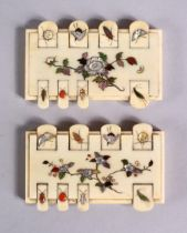 A PAIR OF JAPANESE MEIJI PERIOD SHIBAYAMA IVORY GAMES COUNTERS, each inlaid with semi precious