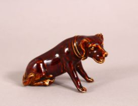 A SMALL CHINESE PORCELAIN FIGURE OF A DOG - 8CM