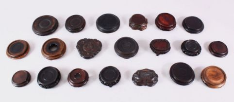 A MIXED LOT OF 20 CHINESE CARVED HARDWOOD STANDS - each of varying size, style and timber, the