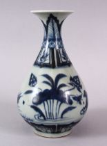 A CHINESE BLUE & WHITE MING STYLE PORCELAIN FLARED VASE, decorated with ducks amongst lotus, base