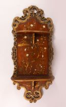 A CARVED WOOD & LACQUER CHINESE WALL SHELF UNIT, with twin folding shelves, the panel decorated with