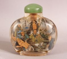 A CHINESE REVERSE PAINTED SNUFF BOTTLE - painted with immortal figures in landscapes and signed -