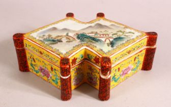 A CHINESE FAMILLE ROSE PORCELAIN BOX & COVER - the li decorated with a landscape view with a red