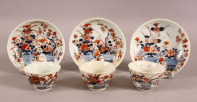 A MIXED LOT OF THREE CHINESE IMARI TEA BOWLS & SAUCERS - Each decorated in similar style with flora