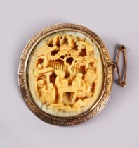 A CHINESE CANTON CARVED IVORY BROOCH, mounted in gold coloured metal ( possibly gold ), carved