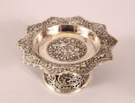 A 19TH CENTURY CHINESE SILVER STEM DISH - Decorated with relief of birds and foliage - 11cm