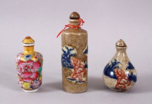 THREE CHINESE PORCELAIN SNUFF BOTTLES, one of floral design, the other two with underglaze blue