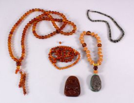 A BOX OF MIXED CHINESE BEADS AND TWO PENDANTS.