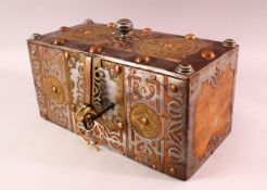 A FINE NORTH AFRICAN TUAREG STEEL, COPPER AND BRASS BOUND WOODEN CASKET, with pierced and
