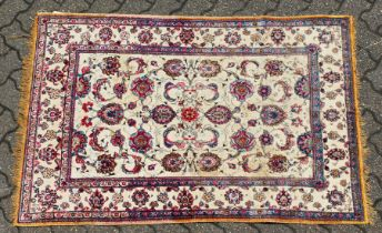 A GOOD SMALL SOUF KASHAN SILK RUG, beige ground with stylised palmettes, within a similar border.