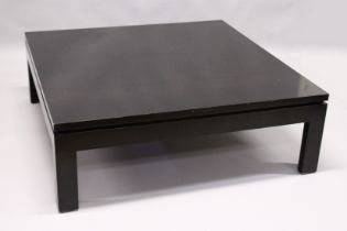 A LARGE EBONISED COFFEE TABLE, 20TH CENTURY, on square legs. 3ft 11.5ins x 3ft 11.5ins x 1ft 4ins.