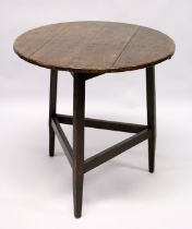 AN 18TH CENTURY STYLE CRICKET TABLE , the circular top supported on three square legs united by