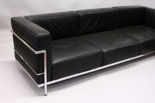 IN THE MANNER OF LE CORBUSTIER, A LARGE CHROME FRAMED THREE SEATS SETTEE, with black leather