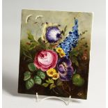 A GERMAN PORCELAIN PLAQUE PAINTED with flowers 9ins x 7.25ins