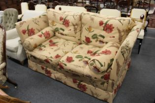 A GOOD MODERN KNOLL LARGE TWO SEATER SETTEE, upholstered in a broad floral print fabric