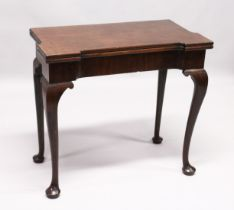A GEORGE III MAHOGANY FOLD OVER CARD TABLE with a shaped rectangular top, green beize lining with