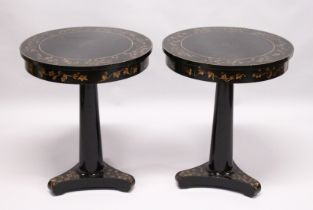 A PAIR OF BLACK LACQUER CIRCULAR PEDESTAL TABLES, 20th Century, the tops frieze and tricorn base