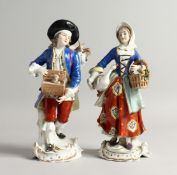 A PAIR OF SAMSON CHELSEA DERRY PORCELAIN FIGURES, a man with a rabbit in a box, a girl carrying a