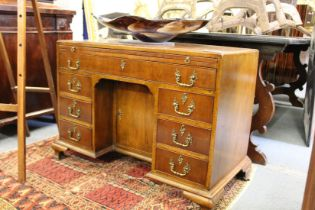 A GEORGE III MAHOGANY KNEEHOLE DESK with plain top and brushing side, long drawer over a kneehole