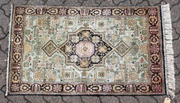 A SMALL PERSIAN PART SILK RUG. 4ft 4ins x 2ft 7ins.